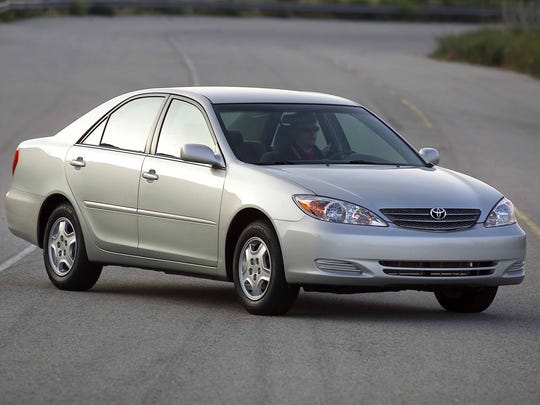 This undated photo provided by Toyota shows the 2002 Toyota Camry. The Camry got taller and wider in 2002, for a much more upscale look. That year, the car overtook the Accord and other rivals for good, and it has remained the best-selling sedan in the U.S. every year since then. (Toyota)