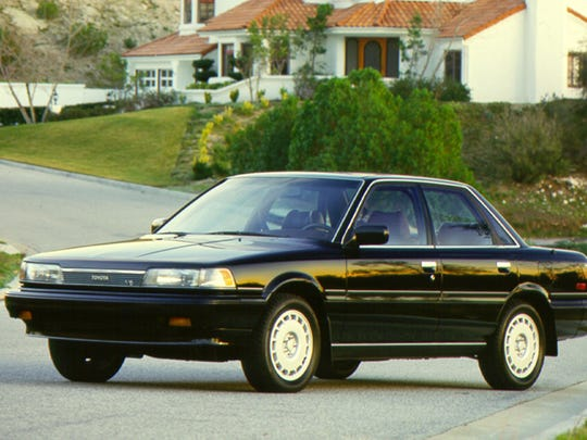 This photo provided by Toyota shows the 1987 Toyota Camry. In the first major redesign since it debuted in 1983, the 1987 Camry looked more upscale and offered a quieter, cushier ride. It was also longer and had more power. (Toyota)