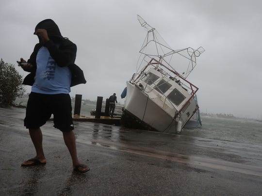 845404484.jpg MIAMI, FL - SEPTEMBER 10:  A boat is washed on shore at the Watson Island marina as Hurricane Irma passed through the area on September 10, 2017 in Miami, Florida. Hurricane Irma, which first made landfall in the Florida Keys as a Category 4 storm on Sunday, has weakened to a Category 2 as it moves up the coast.