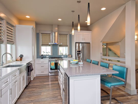 The kitchen blends seamlessly with the living space
