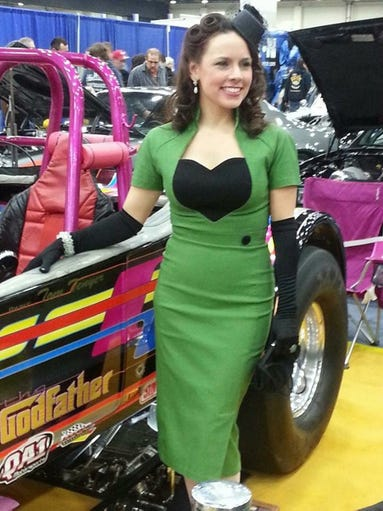 "Shawna Tenyer stands with her dragster ""The Godfather,"""