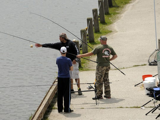 FILE - Carp Fest fishermen in Two Rivers in a previous Wisconsin Carp Championship competition.