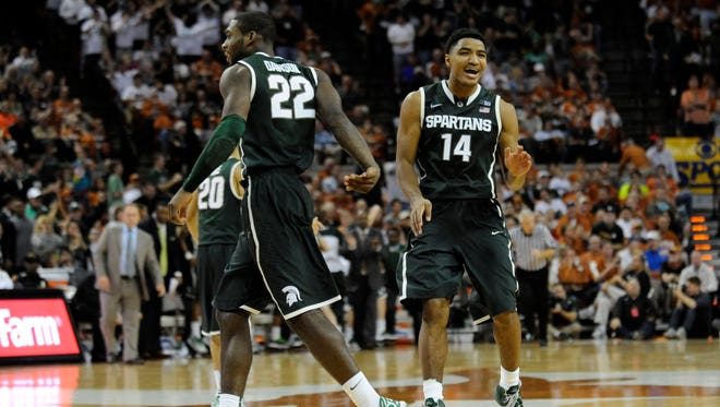 Michigan State Spartans guards Branden Dawson (22) and Gary Harris (14) react against the Texas Longhorns during the second half at the Frank Erwin Special Events Center. Michigan State beat Texas 92-78.