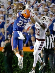 FILE - In this Sept. 3, 2016, file photo, Florida defensive back Chauncey Gardner (23) breaks up a pass intended for Massachusetts wide receiver Bernard Davis (88) during the second half of an NCAA college football game, in Gainesville, Fla. A former high school track star, Gardner is poised to be Florida's next standout defensive back. (AP Photo/John Raoux, File)