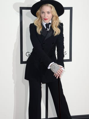 Madonna arrives on the red carpet for the 56th Grammy Awards at the Staples Center in Los Angeles on January 26, 2014. AFP PHOTO/ROBYN BECK (Photo credit should read ROBYN BECK/AFP/Getty Images)