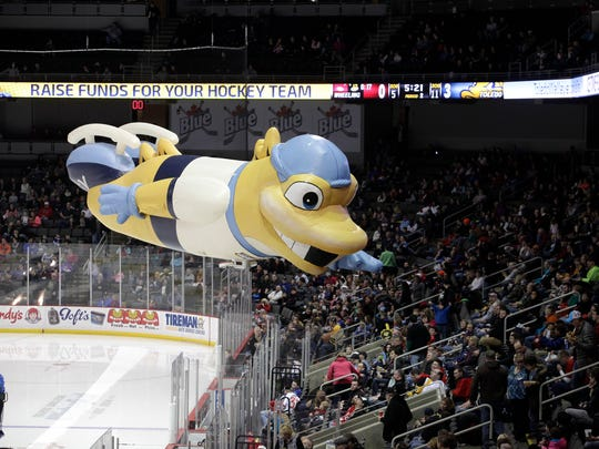 The Walleye float a large inflatable version of its mascot between periods at the Huntington Center, one of many concessions for youth contingent at the game.
