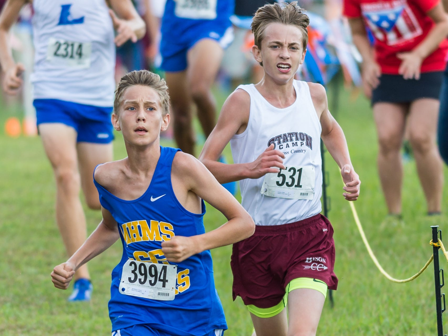 Merrol Hyde Magnet sophomore Garret McGlasson leads Station Camp High sophomore Gabe Forbes near the finish line at Saturday's Beech Invitational cross country meet. McGlasson finished 23rd, while Forbes placed 24th.