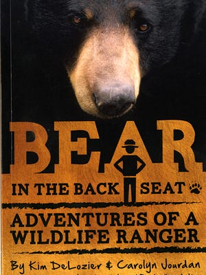 "Smokies biologist Kim DeLozier, and author of ""Bear in the Back Seat,"" will sign copies of his book in the Smokies Mother's Day weekend."