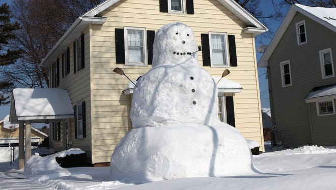 The Hoover Road snowman in Irondequoit  towers in front of the home of it's creator Max Blaise Jr.