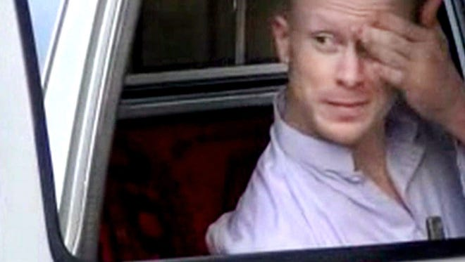 Sgt. Bowe Bergdahl sits in a vehicle guarded by the Taliban in eastern Afghanistan in July 2014.