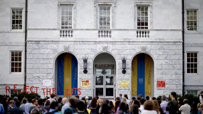Students, faculty and staff protest against proposed cuts to several academic programs outside the administrative offices at Emory University in 2012.