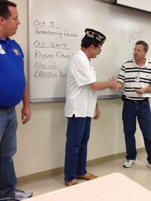 David Butts, (center) of Alley-White American Legion Post 52, presents $500 to Mountain Home Navy Jr. ROTC Senior Chief Troy Peel (right), while Mountain Home Junior High School Principal Ron Czanstkowski looks on. Butts and his wife, Geraldine, also donated $100 to the Navy Jr. ROTC unit. With enrollment up and uniforms in short supply, the donations were appreciated.