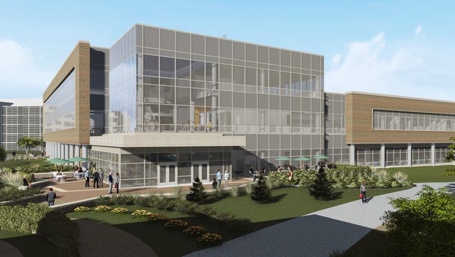 New brick-and-glass Eli Lilly research building will hold 200 scientists when it opens, with room for another 100.