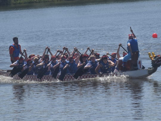 CrossFit Alexandria's dragon boat team competes in one of the heats of the Louisiana Dragon Boat Races held Saturday at Buhlow Lake in Pineville. This year, the CrossFit Alexandria team consisted of all women.