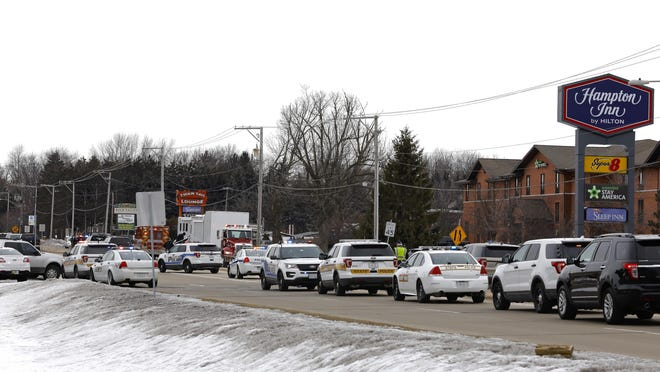 Bell School Road north of State Street is lined with local and state police Thursday, March 7, 2019, after a US Marshal was shot while serving a warrant at Extended Stay America in Rockford.