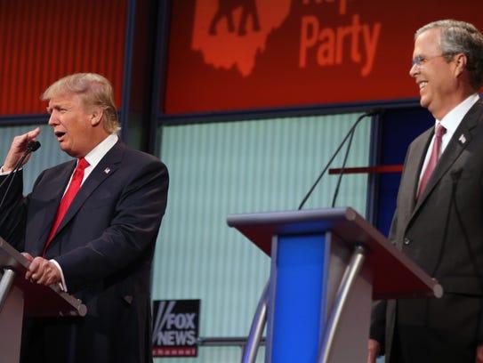 Republican presidential candidate Donald Trump gestures