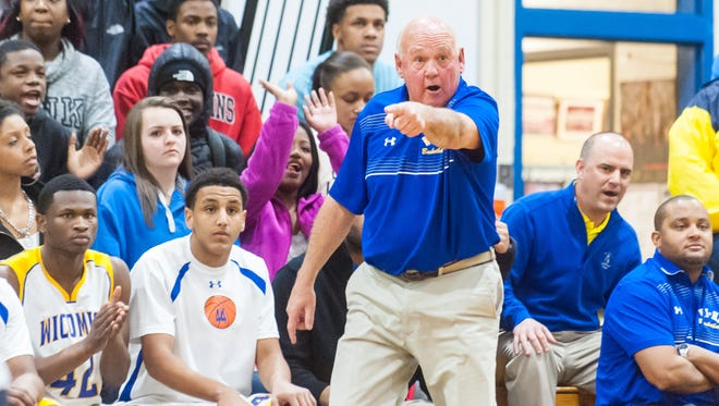 Wicomico head coach Butch Waller moves his players into position from the sidelines against Easton in the 2A East Quarterfinal on Tuesday evening at The Waller Dome.
