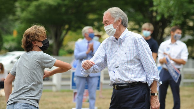 U.S. Sen. Edward Markey, D-Mass., gives an elbow bump to Rhys Adams, grandson of late Republican Gov. Paul Cellucci, during a campaign stop at Falmouth Village Green on Thursday. Rhys introduced Markey at the rally.