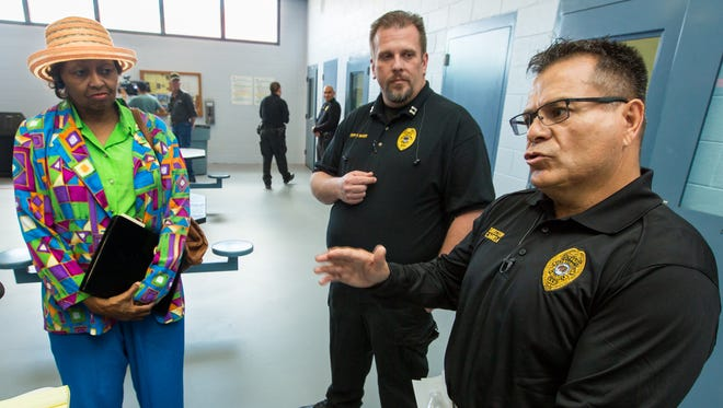 Doña Ana County Detention Center director Chris Barela speaks to the media on Thursday, May, 5, 2016,  during a tour of the Juvenile Detention Center, which will be reopening on Friday. Pictured looking on is Doña Ana County manager Julia Brown, left, and Detention Center Capt. Bryan Baker, center.