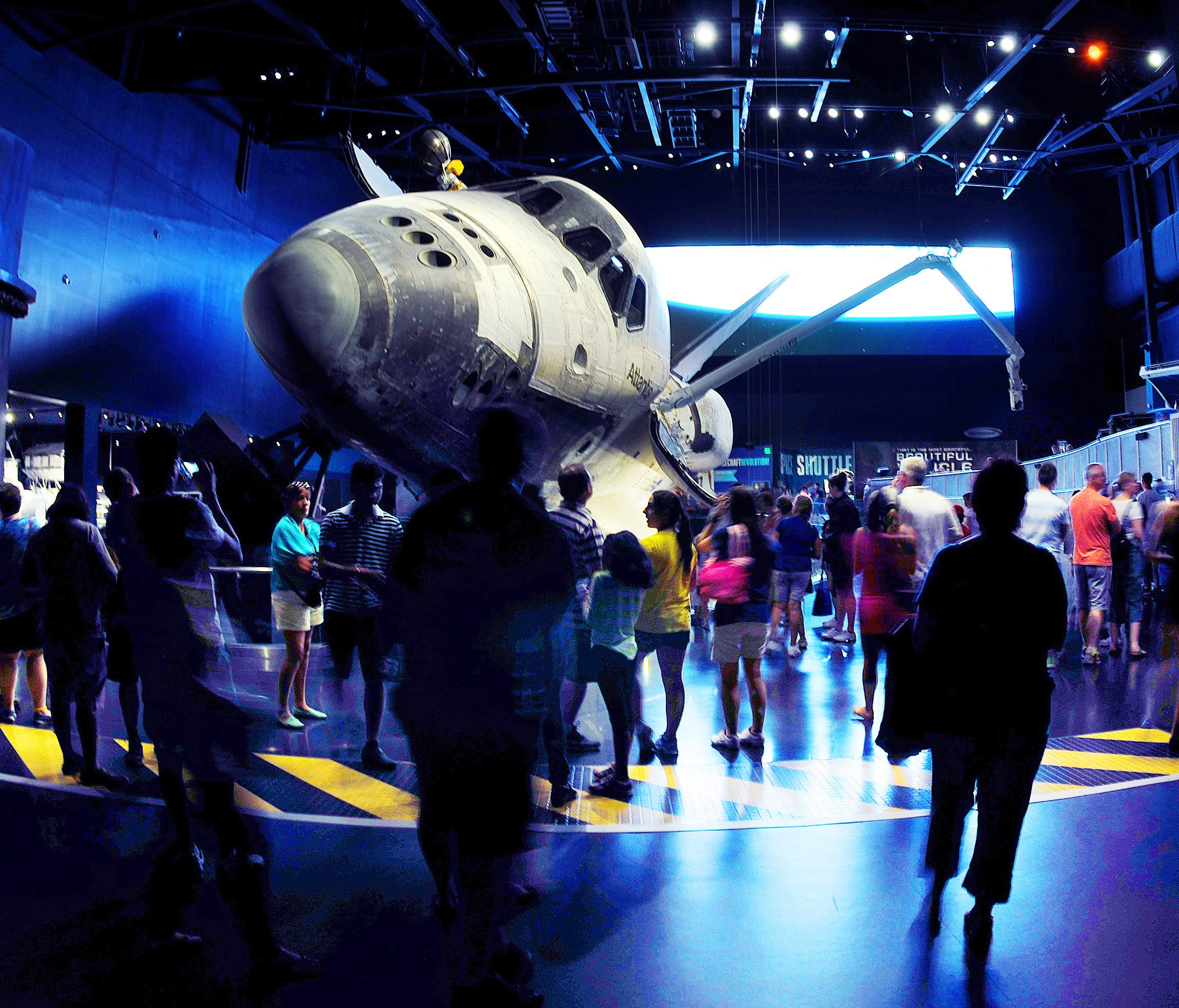 Guests at the Kennedy Space Center Visitor Complex view the Space Shuttle Atlantis exhibit.