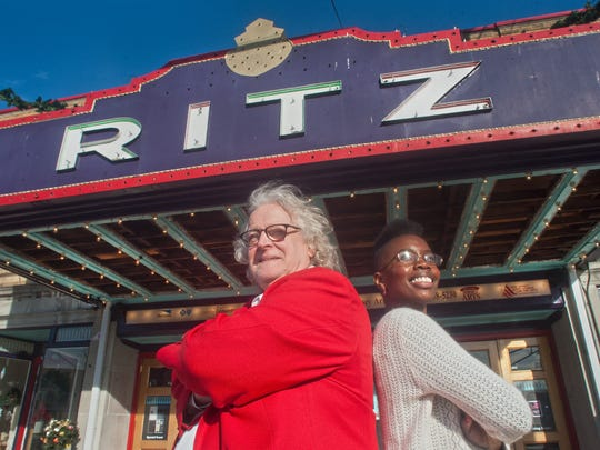 """Bruce A. Curless, Ritz Theatre Company Producing Artistic Director  and Ritz Board President Vedra Chandler stand beneath the marquee of the Ritz Theatre Company in Haddon Township. Chandler, who works for Coopers Ferry, is will perform at """"Honor.Laugh.Give'' in support of Cooper's Pink Roses Teal Magnolia charity."""