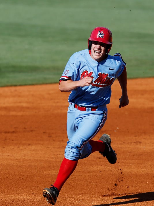 Mississippi's Henri Lartigue, rounds second headed to home to score against Vanderbilt in the second inning of a Southeastern Conference NCAA college baseball tournament game at the Hoover Met, Thursday, May 26, 2016, in Hoover, Ala. (AP Photo/Brynn Anderson)