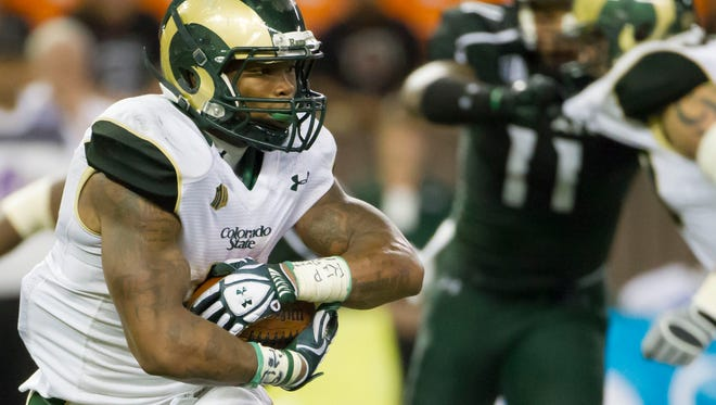 Running back Kapri Bibbs and his CSU football teammates traveled to Hawaii the day before a 2013 game and left with a 35-28 victory. This year's Rams are traveling to Honolulu two days early for Saturday night's game at Hawaii.