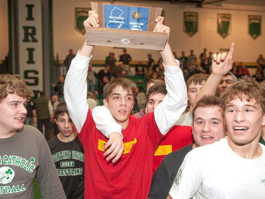 wrestling:  Camden Catholic defeats St. Augustine