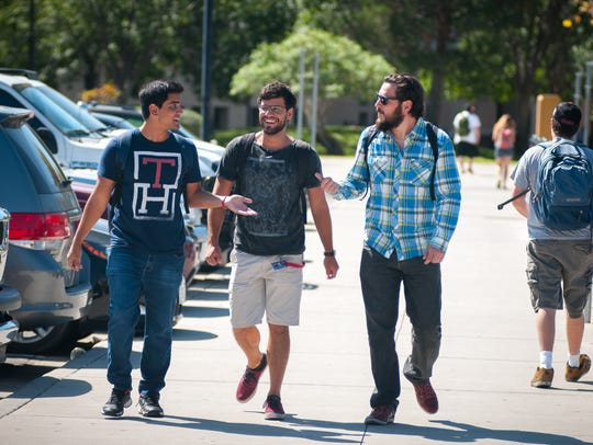 Students walk on the NMSU campus in 2015.