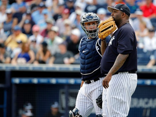 New York Yankees catcher Gary Sanchez (24) comes to the mound to talk with  starting pitcher CC Sabathia (52) during the second inning against the Philadelphia Phillies at George M. Steinbrenner Field on March 24, 2017.