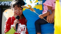 Akemi Vargas, 8, cries as she talks about being separated