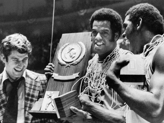 FILE-- Indiana coach Bobby Knight, left, and team members Scott May, center, and Quinn Buckner, are all smiles as they hold the trophy for winning the NCAA Basketball championship in Philadelphia in this March 30, 1976 photo.
