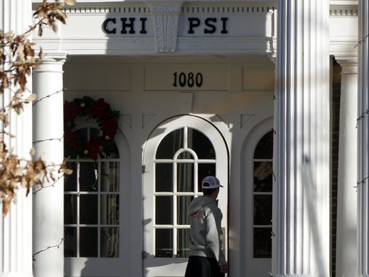 A young man walks into the Chi Psi fraternity house