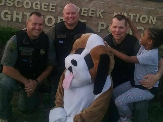 Rosalyn Baldwin, a 7-year-old from Hammond, is traveling the country with her family to hug a police officer in every state. She hugged officers with Creek Nation Lighthorse Police in Oklahoma.