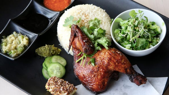 Roasted Spring Chicken is served with rice and a side