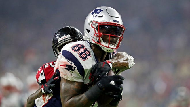 New England Patriots tight end Martellus Bennett (88) catches a pass against Atlanta Falcons strong safety Keanu Neal (22) during the fourth quarter during Super Bowl LI at NRG Stadium.