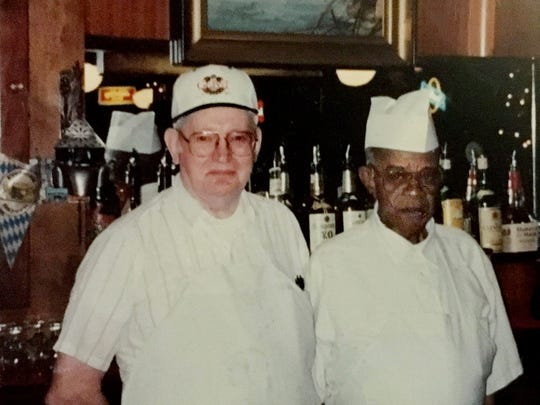 An old photo on the wall in the Gerst Haus shows Gerst kitchen manager Eddie Henderson left and beer waiter Allen Walker in the 301 Woodland Street location.