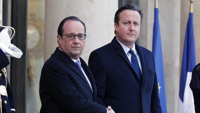 French President Francois Hollande and British Prime Minister David Cameron arrive to attend a meeting at the Elysee Presidential Palace on Nov. 23, 2015, in Paris.