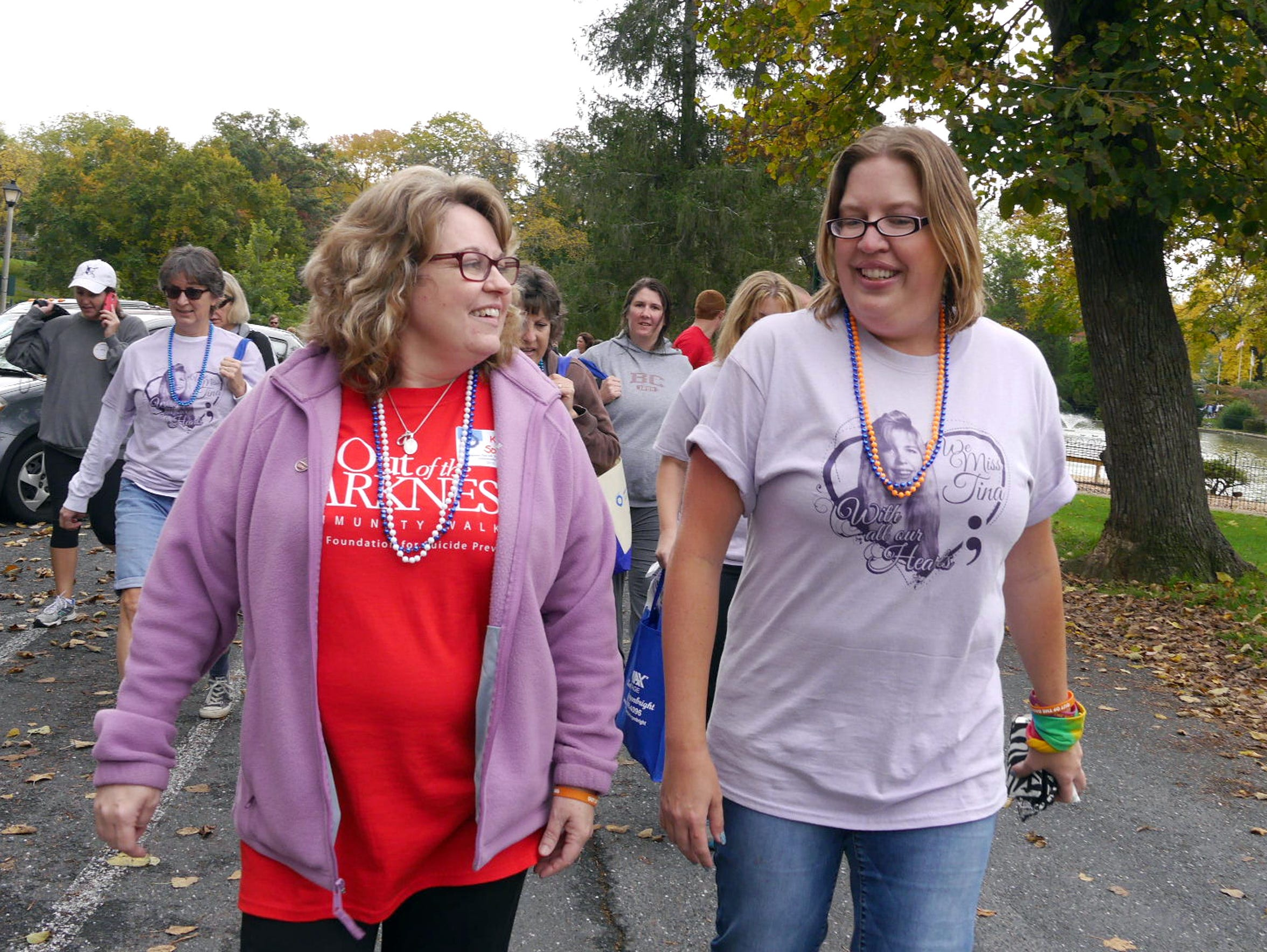 Kim Sours, left, who organized Staunton's Out of the