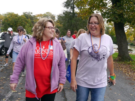 Kim Sours, left, who organized Staunton's Out of the Darkness community walk, talks with Crystal Graham of Waynesboro at the start of the walk. More than 500 people took part at Gypsy Hill Park on  Oct. 10, 2015.