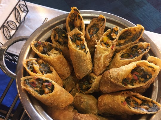 Egg rolls hold spinach, corn, red peppers, black beans,