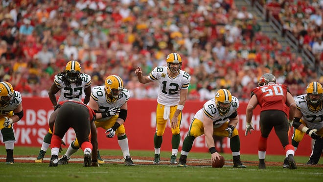 Green Bay Packers quarterback Aaron Rodgers gets ready to take a snap in the second quarter during the game against the Tampa Bay Buccaneers at Raymond James Stadium.