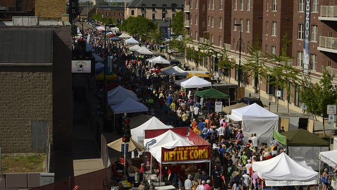 People attend the Saturday Farmers Market in downtown Green Bay in 2014.