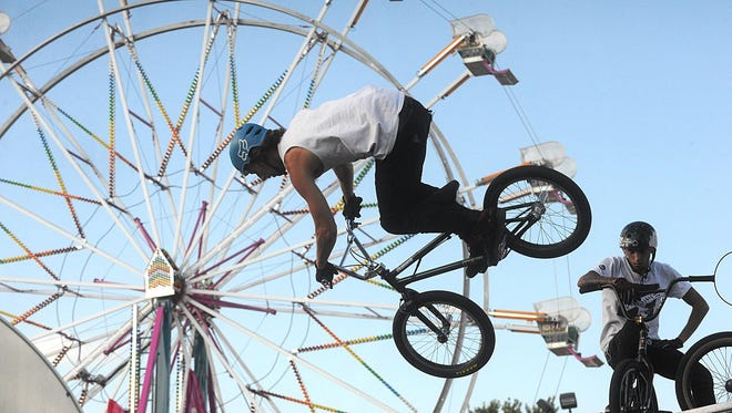 A BMX stunt show performed at the fair, near the Grande Cheese Kids Carnival Corral.