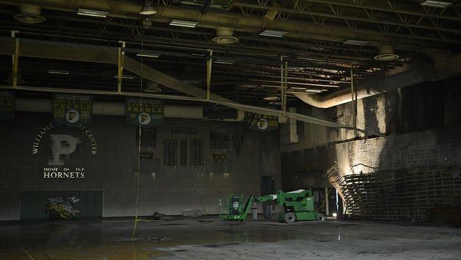 Fire damage inside the main gymnasium at Green Bay Preble High School following an Aug. 8, 2014 fire.