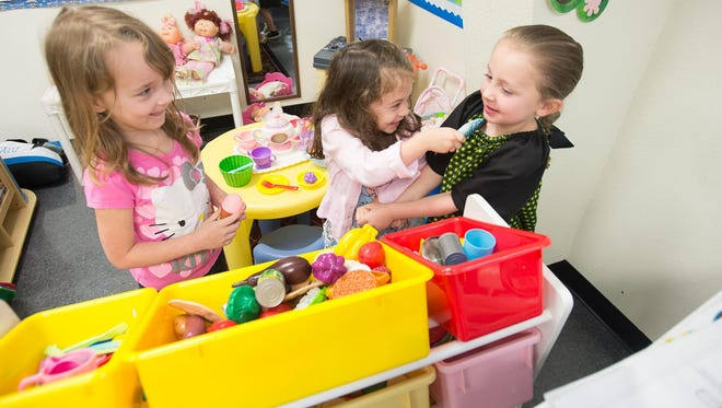 From left, Anna Simpson, Katlyn Sanchez and Keaton Braswell play in the home living area during VPK class last April at the Gonzalez United Methodist Child Enrichment Center in Cantonment.