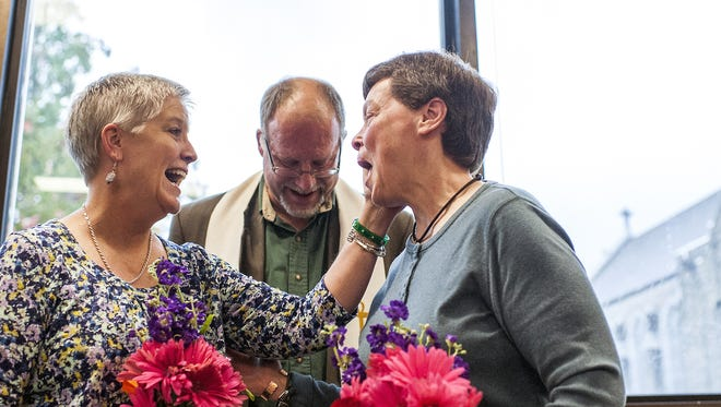 """Cathy McGaughey, left, and Diane Ansley celebrate at their marriage in October. The Campaign for Southern Equality is celebrating the anniversary of the landmark Supreme Court gay marriage ruling Sunday with the premiere of the documentary """"Love Won: The Story of the We Do Campaign."""" The film, produced by award-winning filmmaker Ryan Murdock, will give viewers a behind-the-scenes look at the fight for marriage equality in the South."""