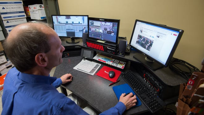 Kevin Bowers, a telecommunications network technician in the judicial information center, prepares the livestream system before closing arguments at the Delaware Supreme Court.