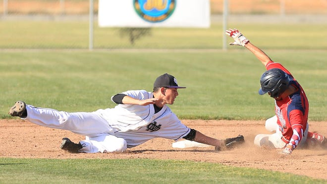 Tulare Western's Jesse Macias avoids being tagged by Mission Oak's Brett Johnson at second base on Friday in an East Yosemite League game at Mission Oak High School.
