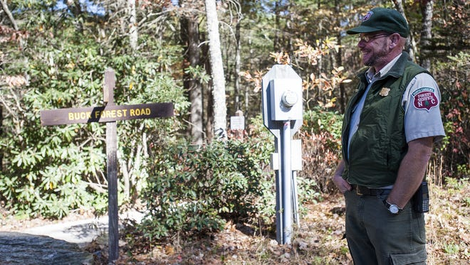 Forest assistant supervisor Bruce MacDonald talks with visitors at DuPont Recreational State Forest southeast of Brevard in this 2014 photo. Whether to give state workers like MacDonald a pay increase is a topic likely to be debated during this year's session of the state General Assembly.